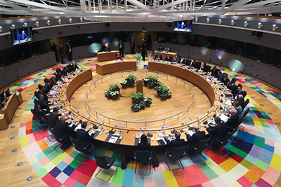 Image shows European Union leaders sitting at a roundtable, shot from above.