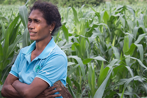 Abelina dos Santos stands in her cassava field in East Timor.