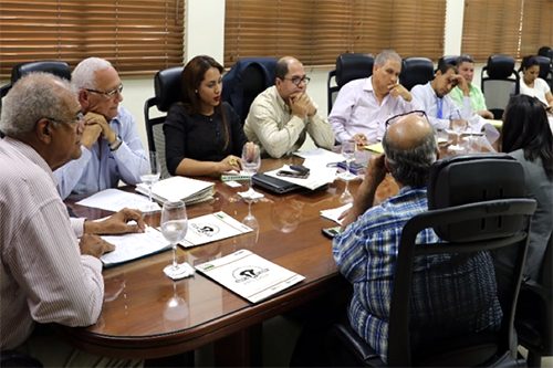Representatives from the Dominican Republic's beef and dairy industry discuss steps to achieve the environmental and health standards necessary to export their products.