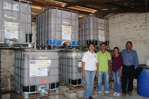 "María Botto and members of the ""Pinar Montenegro"" group inside the Eco-Friendly Fertilizers Alotepec Factory."