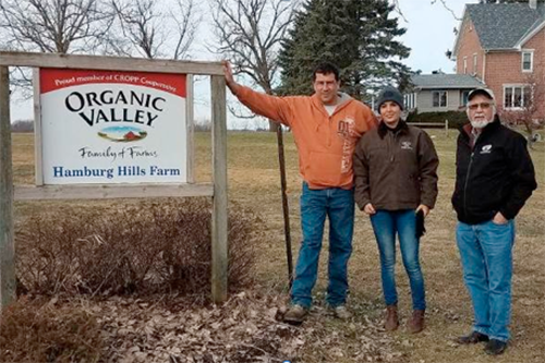 From left: Hamburg Hills Farm owner Tim Servais with Leidy Casimiro and Organic Valley's Jim Wedeberg.