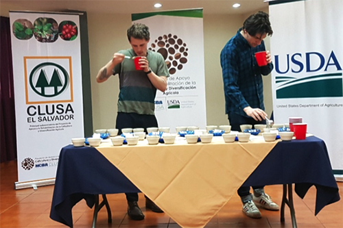 Benjamin Evar and Esben Piper, business partners with La Cabra Coffee Roasters, cup coffee samples at La Palma, Chalatenango.
