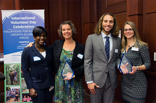 NCBA CLUSA's two Volunteer of the Year Award winners Erin Schneider and Matthew Amato with their nominating program team Linda-Ann Akanvou and Virginia Bunker at today's International Volunteer Day event.