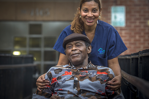 Home care cooperative worker-owner Rosa Tavarez with her client Floyd Betts. [photo: Dave Sanders/CHCA]