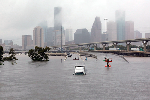 Houston's Highway 45 is submerged in the wake of Hurricane Harvey. [photo: Reuters/Richard Carson]