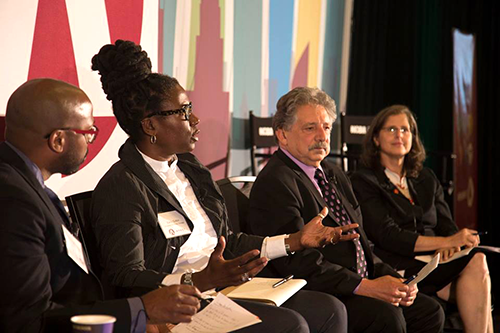 Ellis Carr, left, president and CEO of Capital Impact Partners, moderates an IMPACT 2017 panel including Stacy Sutton, Mayor Paul Soglin and Councilmember Helen Rosenthal.
