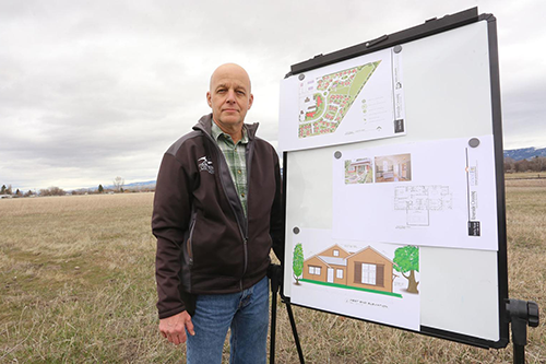 Paul Travitz stands on land where Montana's first housing cooperative will be constructed.