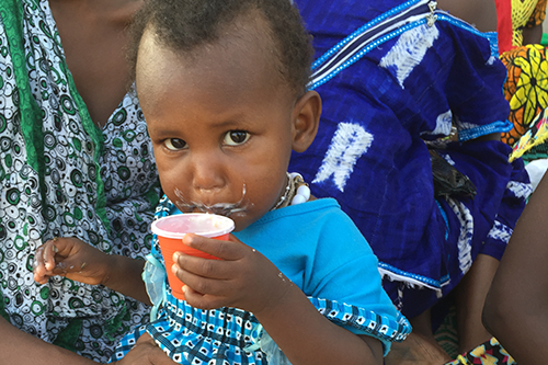 When children can access enriched flour and porridge in their village markets, they grow up stronger and healthier.