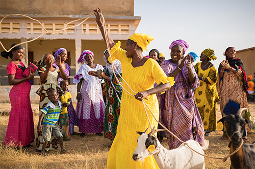 "This photo, depicting a ""Passing on the Gift"" ceremony in Senegal from the Yaajeende Project, exemplifies the community connections needed to end global hunger. [photo: Yaajeende]"