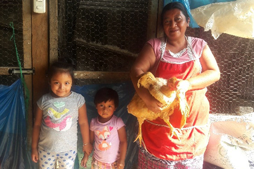 Zoila started her poultry business with access to credit from her village savings and loan group.